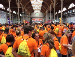 Packed hall full of people dressed in orange t-shirts at the Techies4TempleStreet event in the RDS; PR, digital marketing, social media marketing, social media, Irish tech sector, Public Relations, content marketing