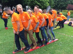 The Comit team on a set of six-person red skiis in a park; PR, digital marketing, social media marketing, social media, Irish tech sector, Public Relations, content marketing